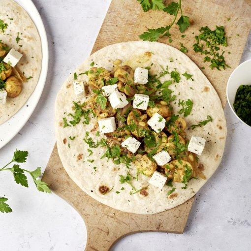 Wraps met ras el hanout champignons, feta en peterselie
