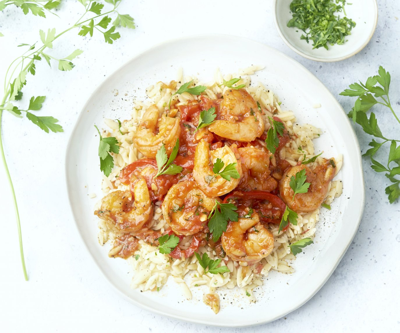 Pittige Spaanse scampi's met orzo