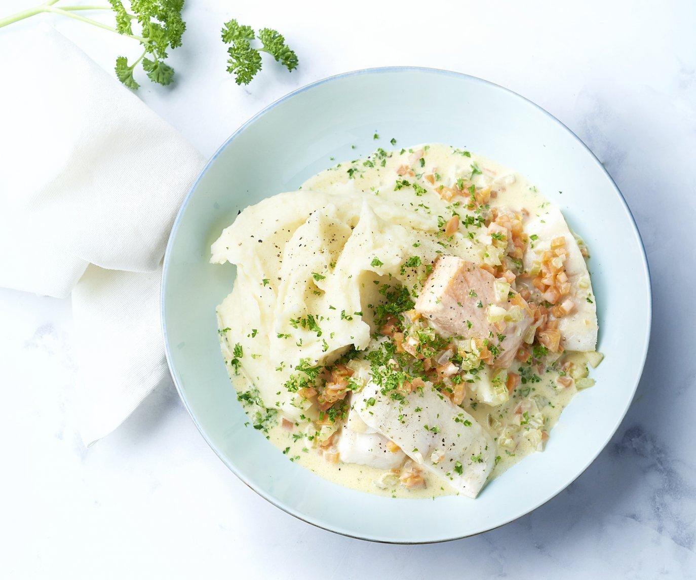 Gepocheerde vis met wittewijnsaus en puree
