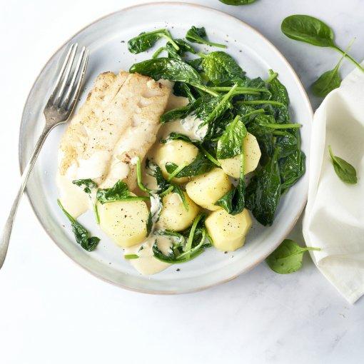 Witte vis met spinazie en mosterdroomsaus