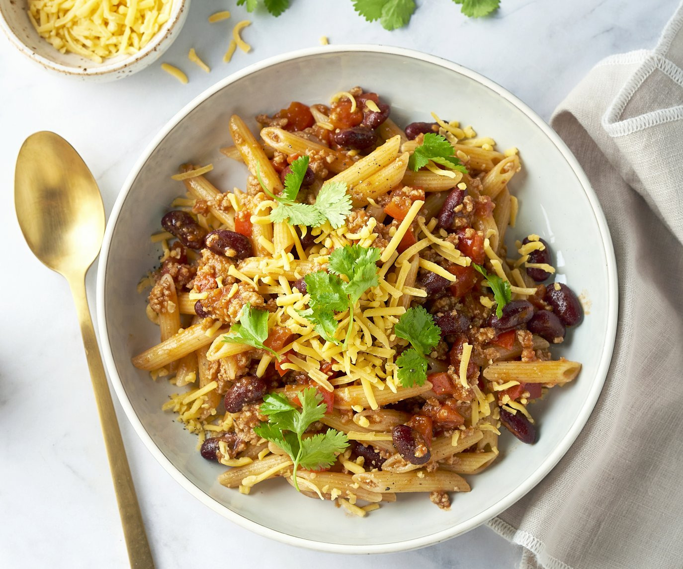 Penne chili con carne met cheddar